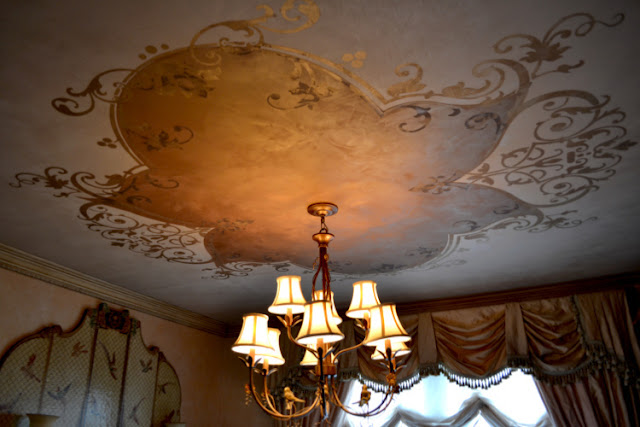 ornnate plaster design on a dining room ceiling