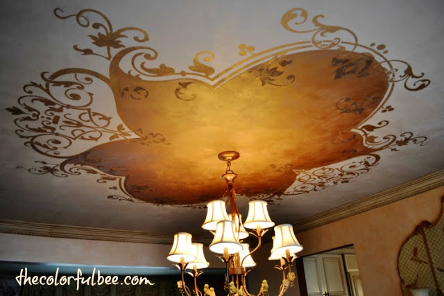 Modello design on a metallic plaster ceiling in a dining room