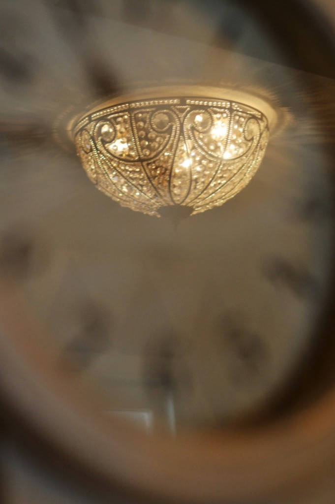 ceiling fixture in a blurred clock face