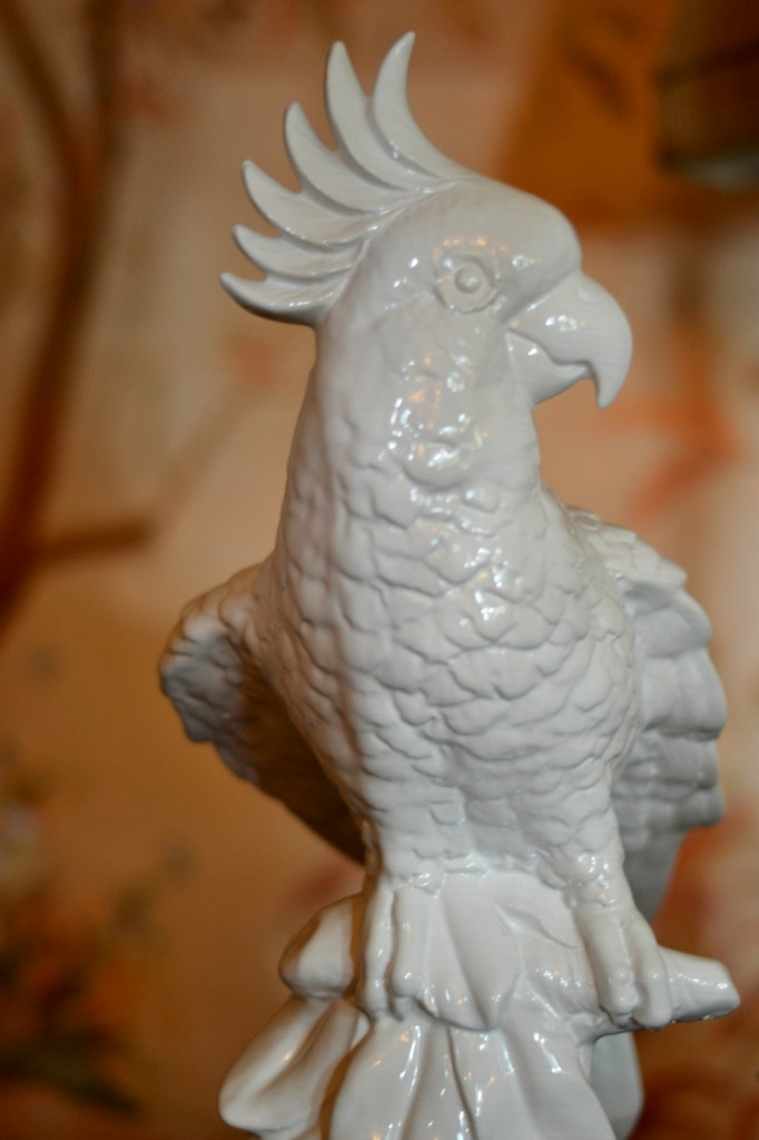 Porcelain cockatoo bird in a living room