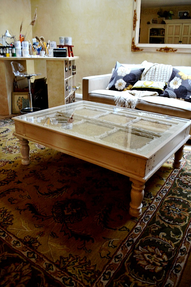 Antiqued coffee table with project table in my art studio