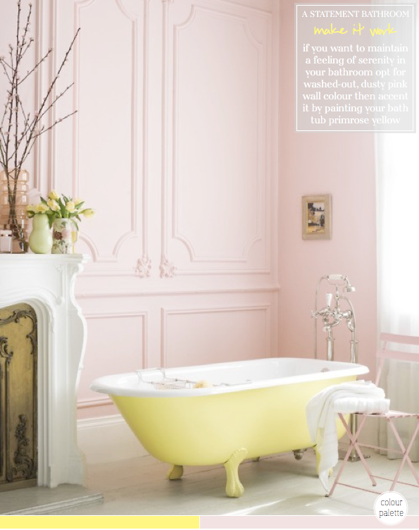 pale yellow bathtub in a pale pink bathroom