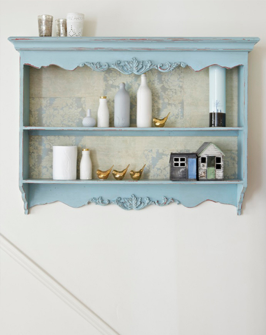 Blue cabinet shelf styled by Pippa Jamison