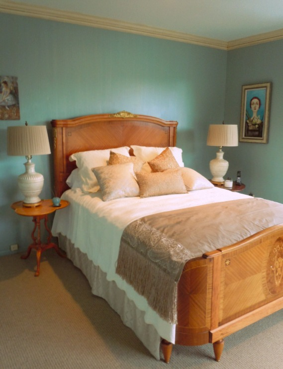 A guest room with Benjamin Moore Staffordshire Blue with a pearl strie