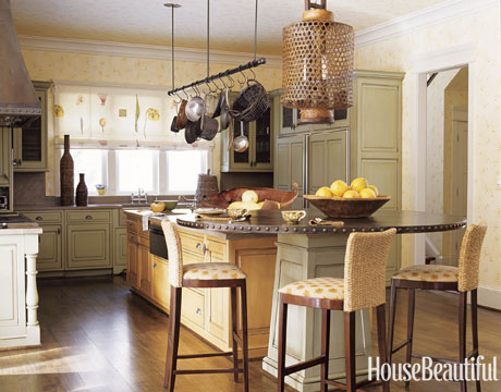 "A beautiful yellow hued kitchen by designer ""Barry Dixon"""