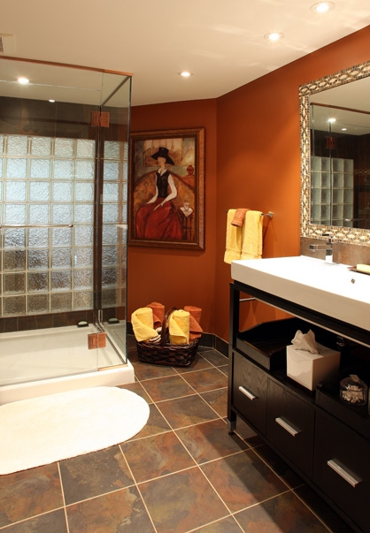 warm orange color in a bath, using ornage in interior design, ornage paint colors