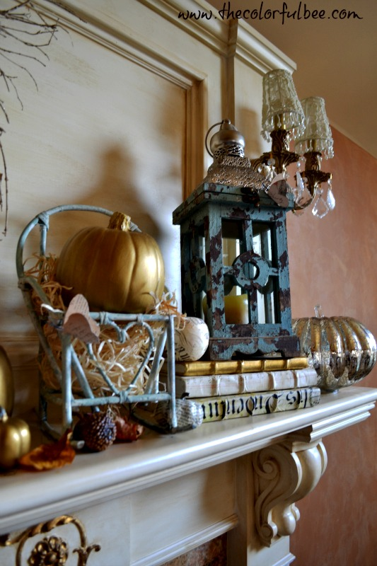 antique blue lantern on a fall mantle
