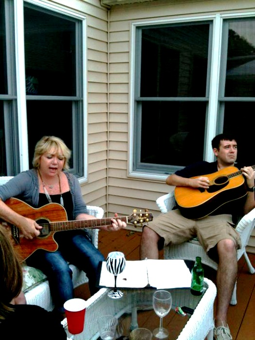 playing guitars at a party