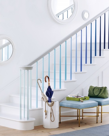blue ombre effect on the spindles of a staircase from Martha Stewart
