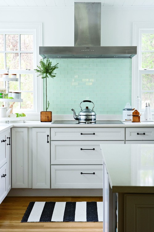 sky blue backsplash tiles in a kitchen