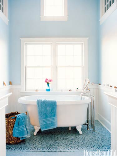 Blue bathroom with Farrow and Ball's Borrowed light; mosaic tiles floor, cast iron bathtub