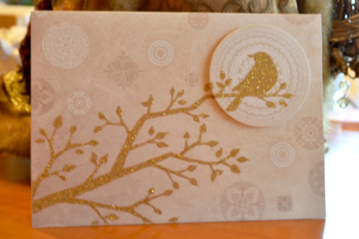 Christmas card with gold glittered bird in a tree