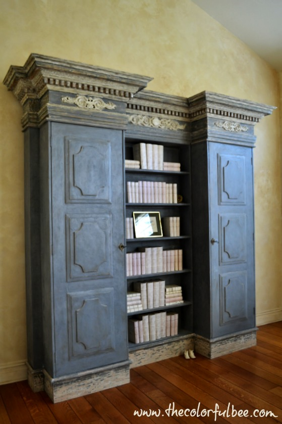 rustic plaster wall and an antiqued bookcase from Tata Shaw