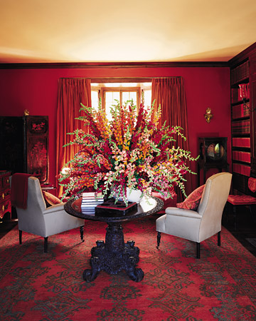 red dining room with Chinese screen, light being dining chairs, faux bois panelling, Martha Stewart