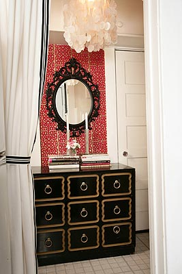 red and white wallpaper, black Dorothy Draper chest and white drapes