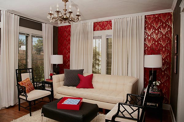 red wallpaper and white drapes, black accents
