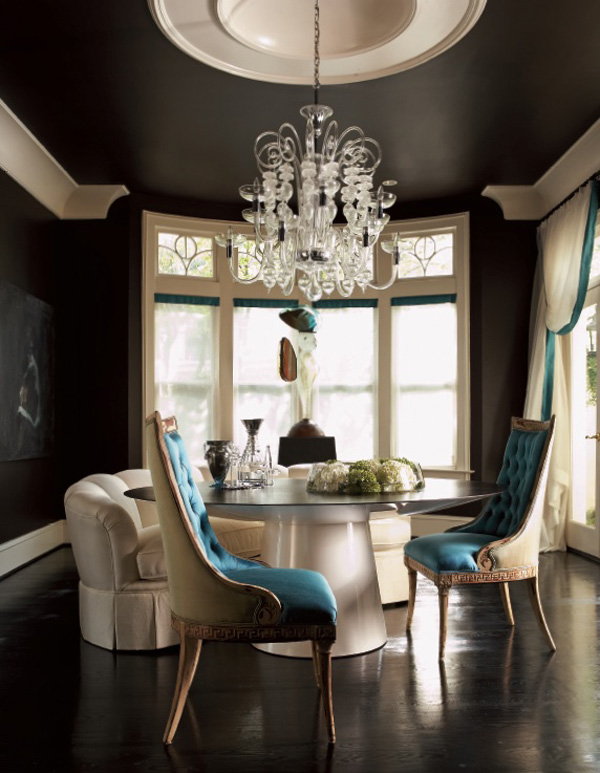 black dining room with large white moldings and blue accents