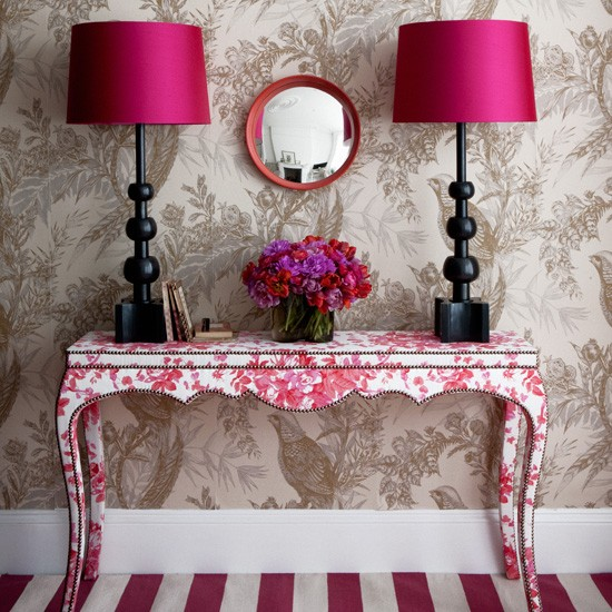 toile console, fuchsia lampshades and striped rug in ana entryway