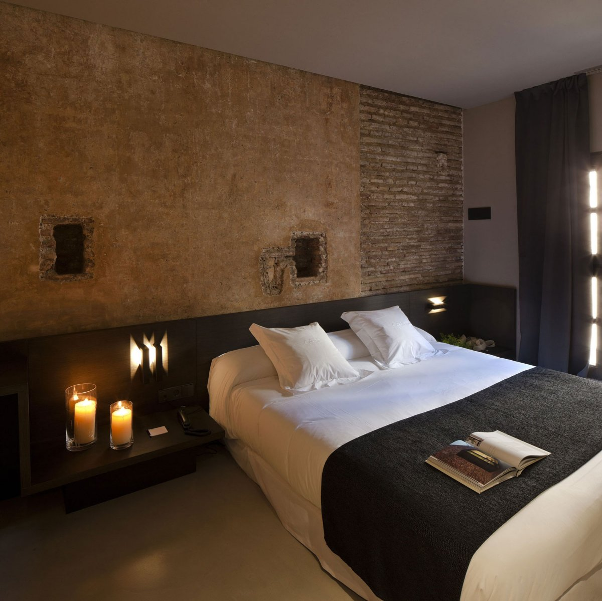 Caro Hotel in Valencia Spain. Rustic walls and new furnishings