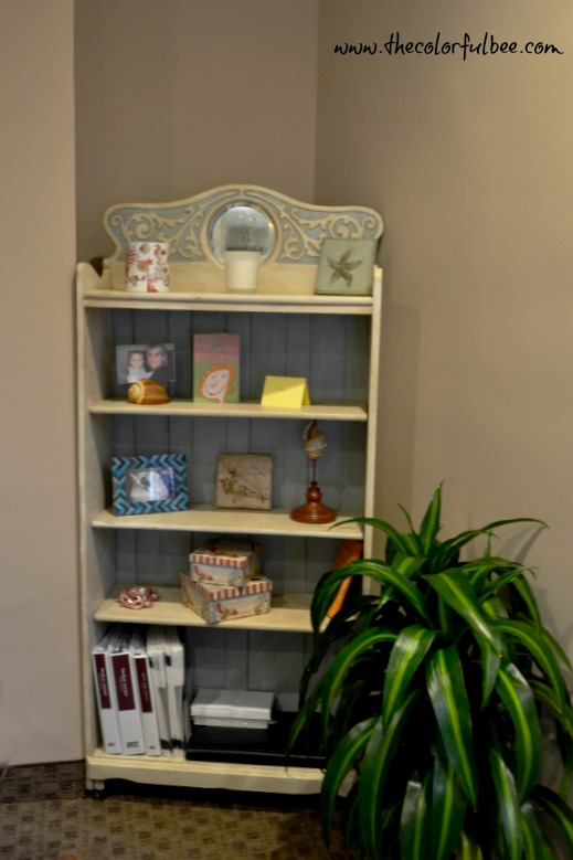 a revamped antique bookcase with off white and pale blue paint and antiqued