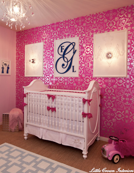 fuchsia and silver damask wallpaper in a girl's nursery