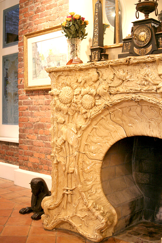 beautiful, ornate stone  fireplace