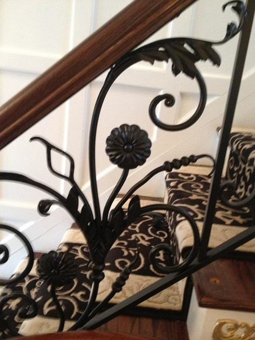 plain black powder coated railing before the gold application