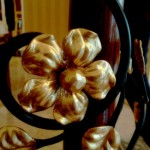 closeup of wrought iron flower with gold paint