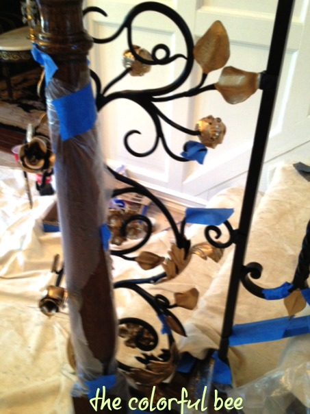 starting to apply the gold to the wrought iron railing