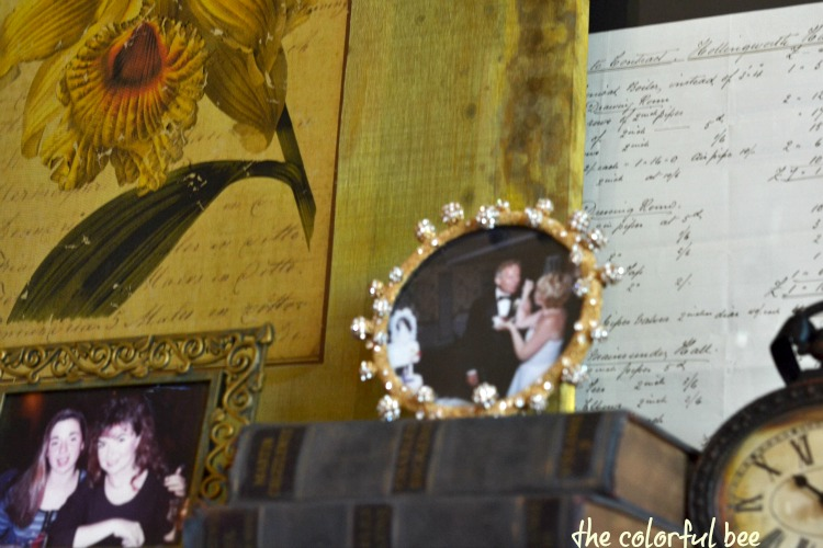 family photos on a fireplace mantle