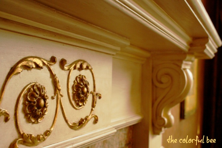 gilded and antiqued mantle and onlays on a fireplace mantle