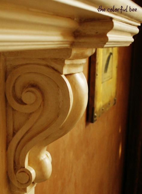 antiqued mantle and soft matte plaster walls
