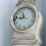 a distressed and antiqued Swedish Mora Clock