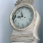 a distressed and antiqued Swedish Mora Clock