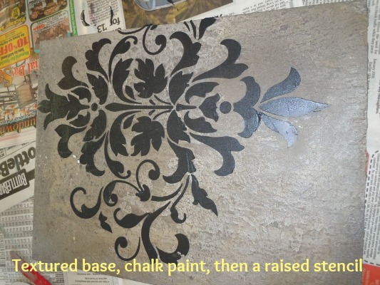 a textured base, Annie Sloan Chalk Paint in Paris Grey, Ebony metallic plaster embossed over it