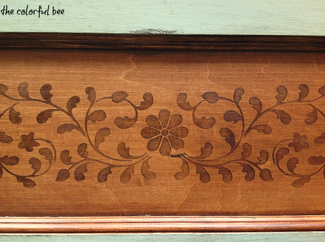 a painted, stained, antiqued wood valance