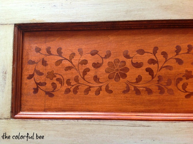 a stained, painted and antiqued wood valance