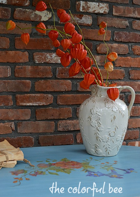 Chinese plantern plants on a blue chalk paint table