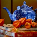blue teapot and orange Chinese lantern pods