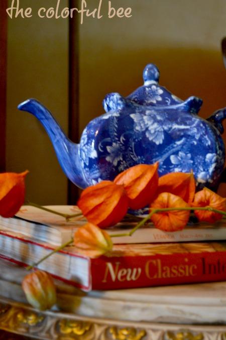 blue teapot and orange Chinese lantern pods