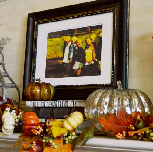 a centerpiece of the fall mantle, a pianting of children going back to school