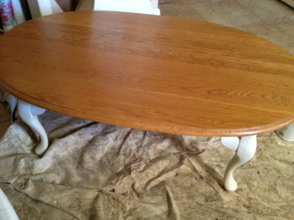 oval oak coffee table before transformation