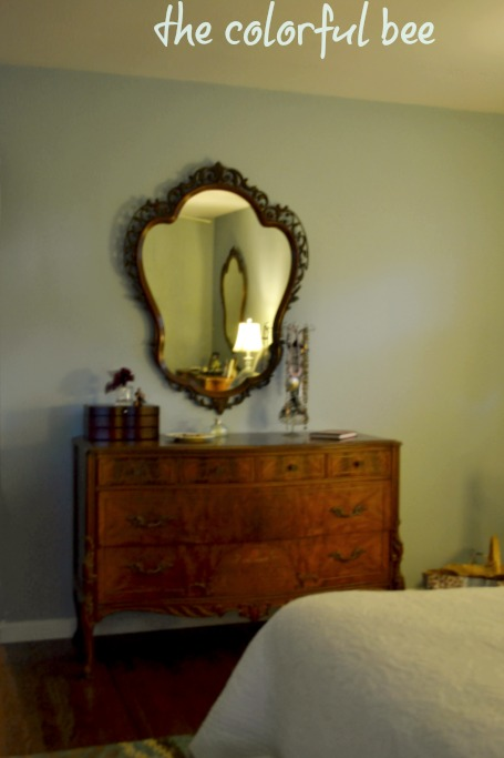 antique dresser and mirror in a Woodlawn Blue bedroom