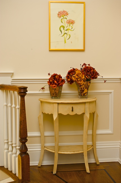 orange flowers in a vase and orange artwork
