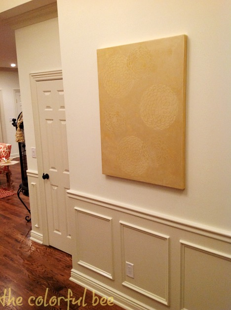 metallic plaster artwork for an entryway in a staged home