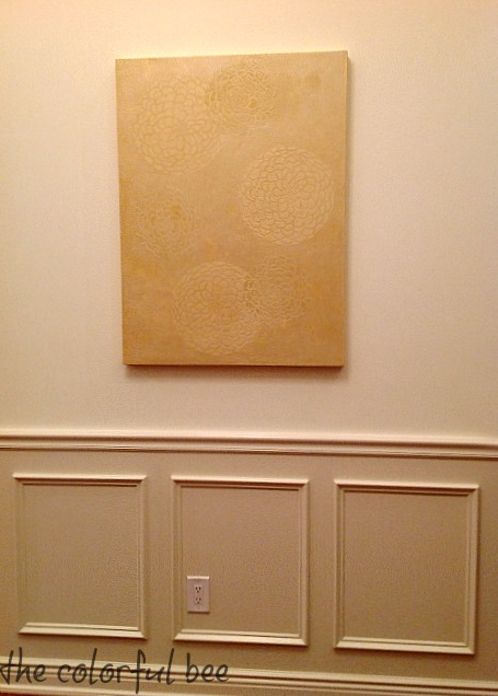 metallic plaster art in entry of staged home