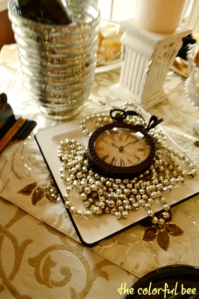 clocks on table set for New Year's celebration