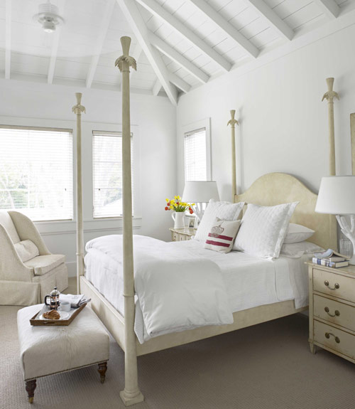 all white bedroom with beautiful architectural ceiling