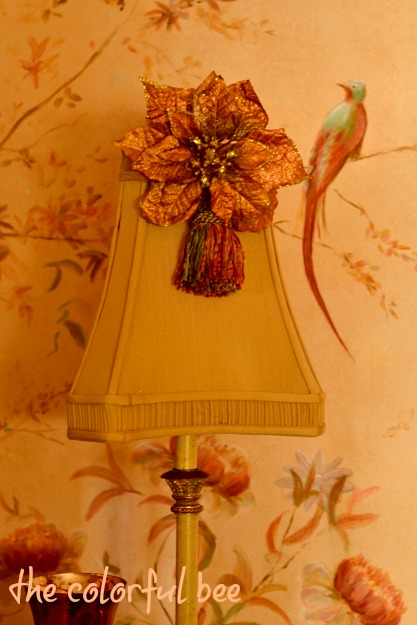 fauc poinsettia and tassel on a lamp