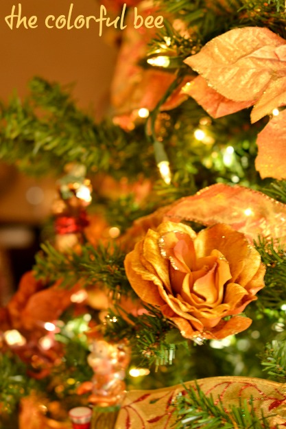 florals and faux poinsettias in Christmas tree